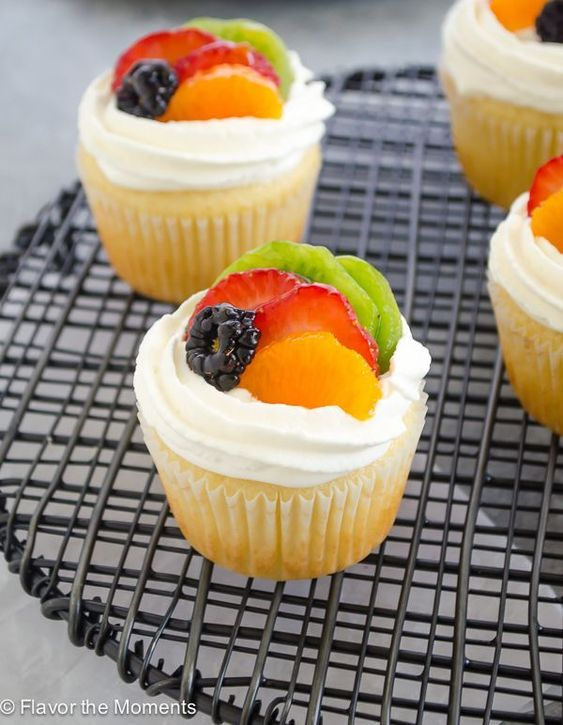 4 Fruit Tart Vanilla Cupcakes on a cooling tray